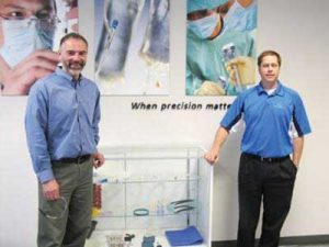 RPN PHOTO BY BRUCE MEYER Bernie Stritzke (left), executive general manager of Qure Medical, and Nick Brust, vice president of sales, at the Qure facility in Sturtevant, Wis. The firm is adding a new clean room there to allow for production of high-volume silicone medical goods.