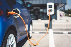 An electric car charges